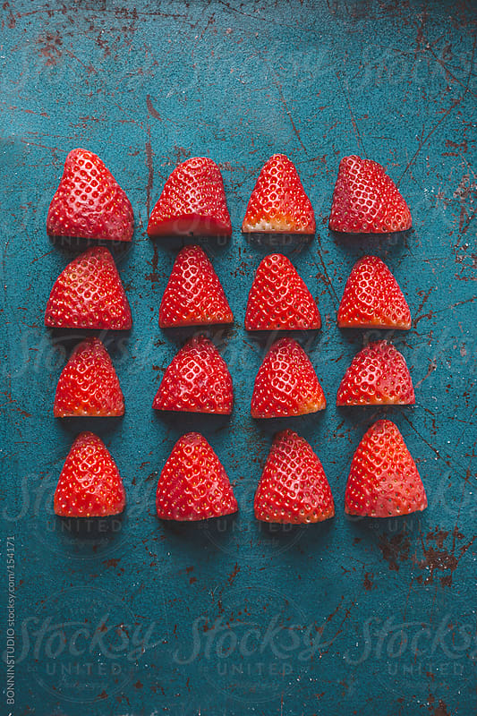 Overhead of strawberries on blue background. by BONNINSTUDIO for Stocksy United