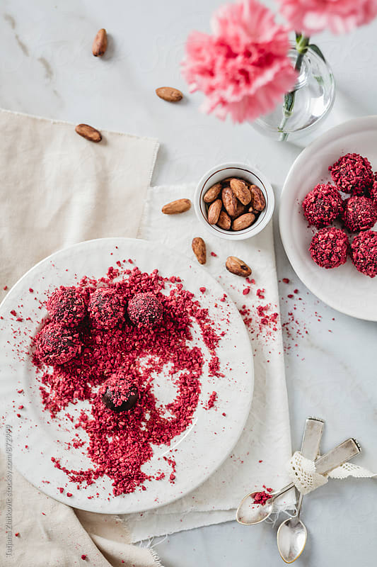 Truffles with chocolate and dried raspberries by Tatjana Ristanic for Stocksy United