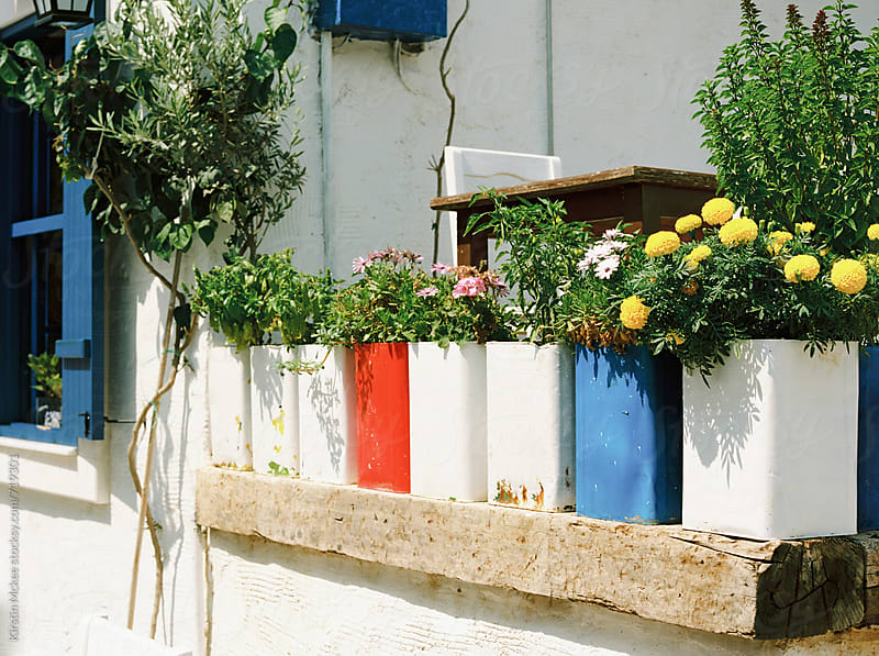 Colourful flower pots in Kalkan, Turkey by Kirstin Mckee for Stocksy United