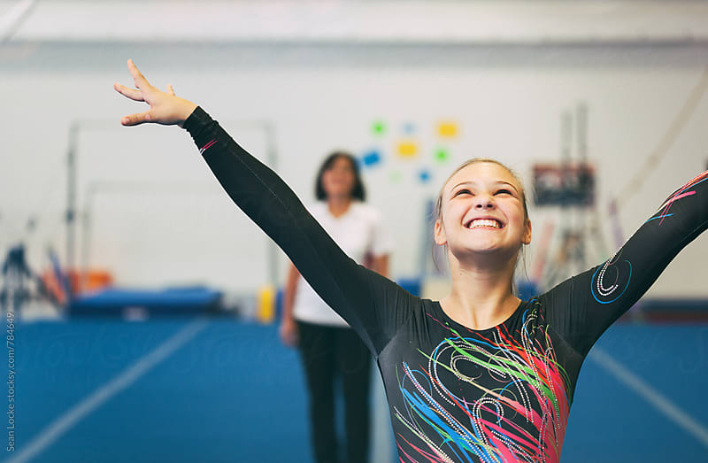 Gymnastics: Girl Strikes Winning Pose After Successful Practice by Sean Locke for Stocksy United