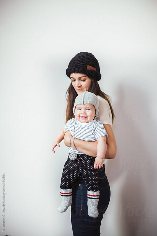 Mother and her baby indoors by Treasures & Travels for Stocksy United