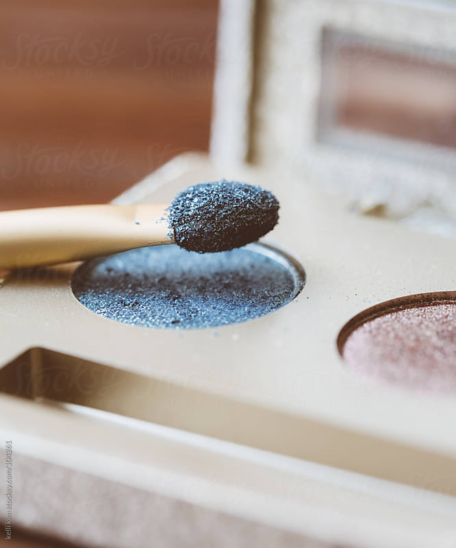 Macro Image Of Pretty Blue Eyeshadow And Applicator by kelli kim for Stocksy United