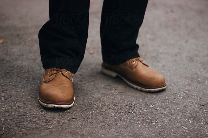 Man in shoes standing on the street by Jovana Rikalo for Stocksy United