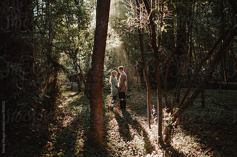 Couple Embracing in Forest by Sidney Morgan for Stocksy United