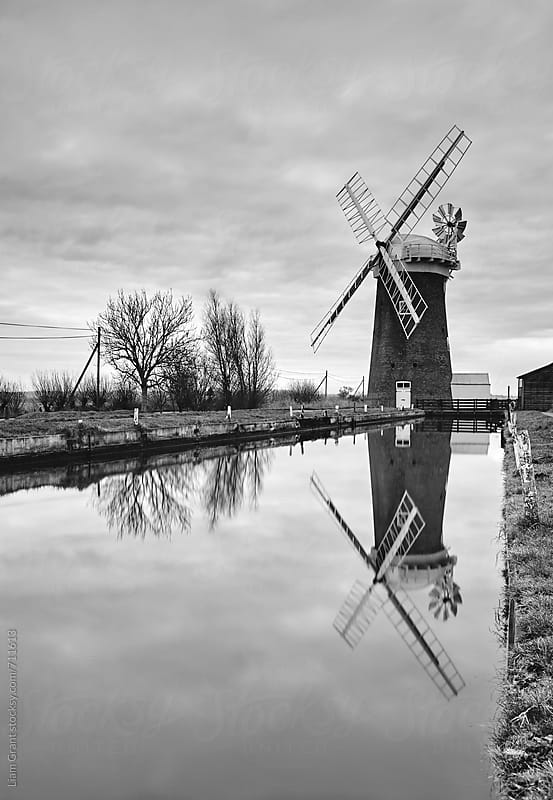 Old windmill on the Norfolk Broads, UK. by Liam Grant for Stocksy United