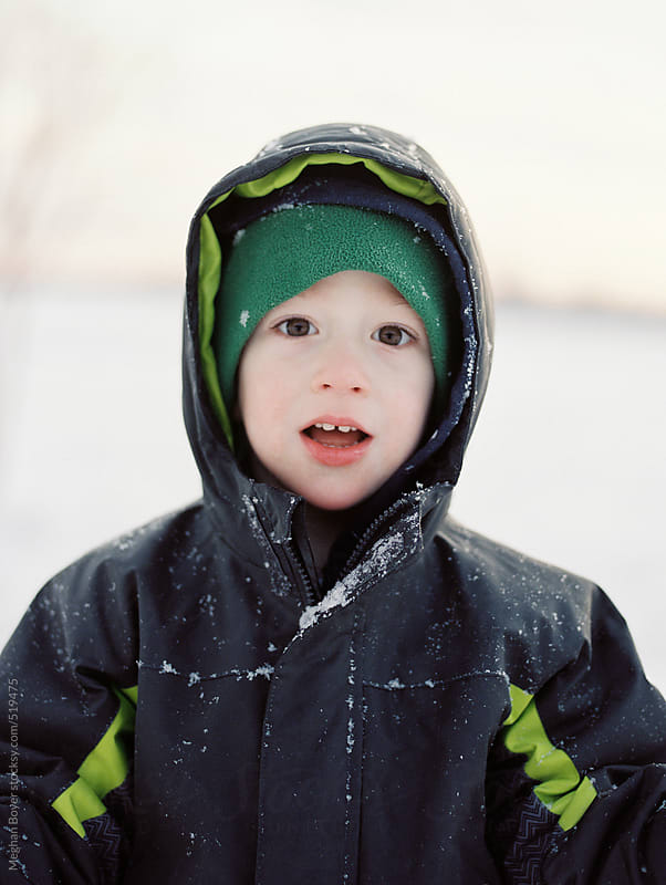 cute little boy dressed to play in the snow by Meghan Boyer for Stocksy United