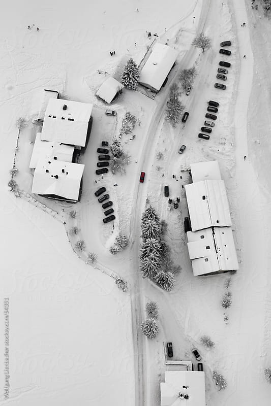 Some houses shot from above with a red car in the center of the frame by Wolfgang Lienbacher for Stocksy United