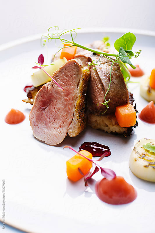 Roast duck with charred leeks,carrots,tayberry jelly,rhubarb puree and potato rosti by Darren Muir for Stocksy United