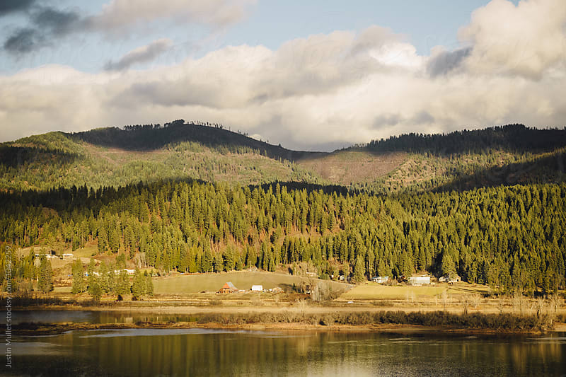 Farm along a river in Idaho.  by Justin Mullet for Stocksy United