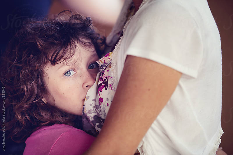 Young girl being embraced by her mother by anya brewley schultheiss for Stocksy United