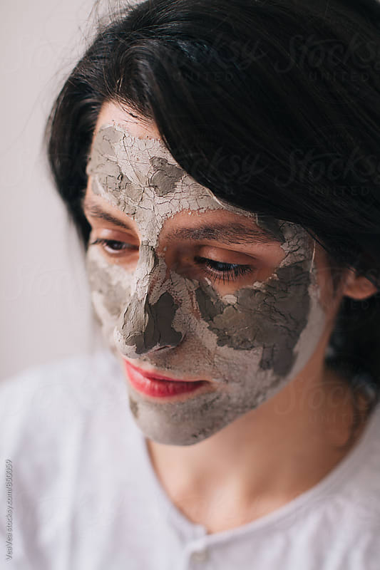 Portrait of a beautiful brunette woman with home made facial mask by Marija Mandic for Stocksy United