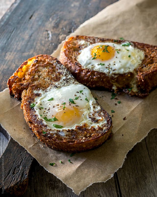 Close-up of two sandwich toasts with eggs by Trent Lanz for Stocksy United