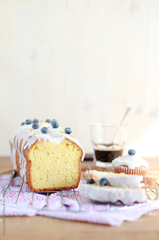 Coconut cake with blueberries by Orsolya Bán for Stocksy United