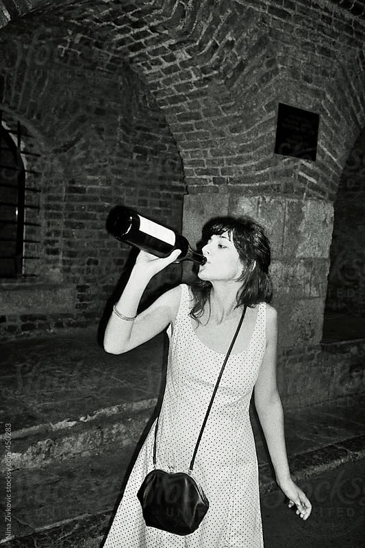 A young girl drinking wine. by Nina Zivkovic for Stocksy United
