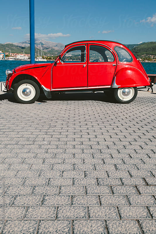 Vintage Car Parked Besides the Sea by VICTOR TORRES for Stocksy United
