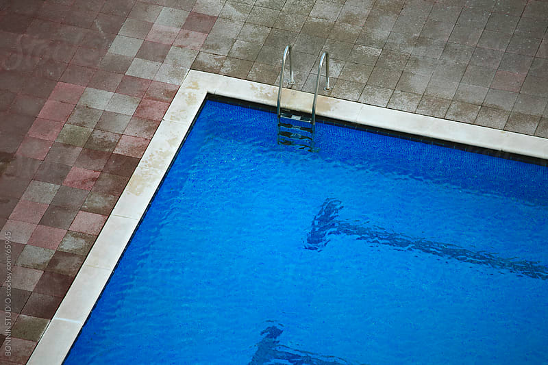 Aerial view of a swimming pool.  by BONNINSTUDIO for Stocksy United