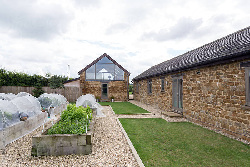Garden and office of a domestic house converted from an old barn by Paul Phillips for Stocksy United