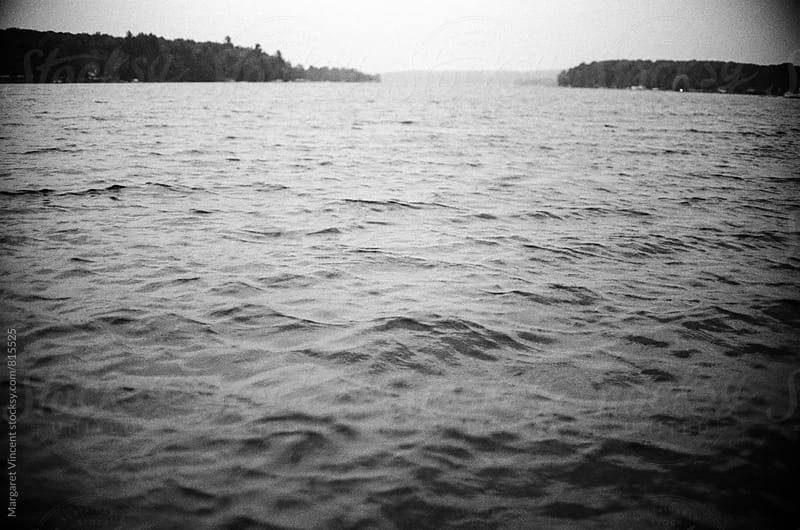lake in black and white by Margaret Vincent for Stocksy United