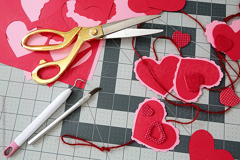 Closeup of diy project for paper heart garland by Sandra Cunningham for Stocksy United