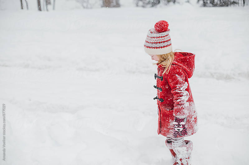 Little Girl stands in the snow by Amanda Voelker for Stocksy United