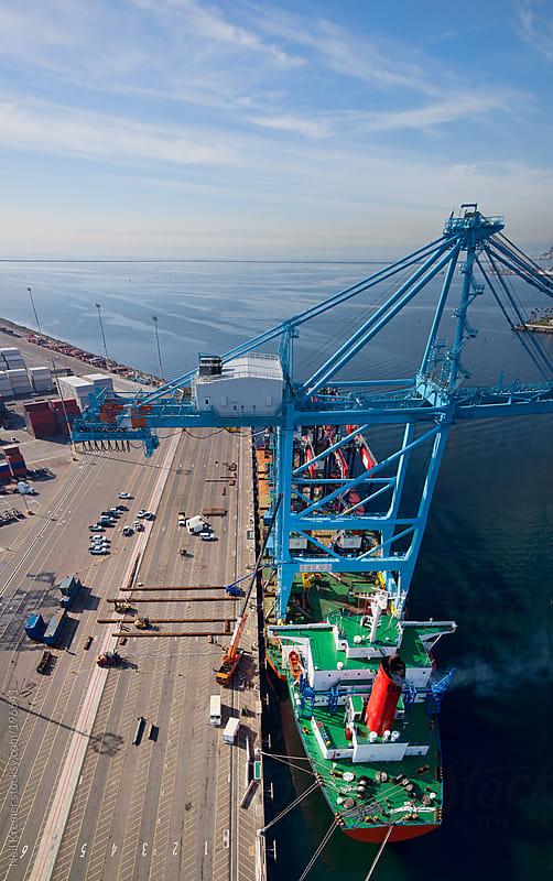Shipping vessel in port by Neil Kremer for Stocksy United