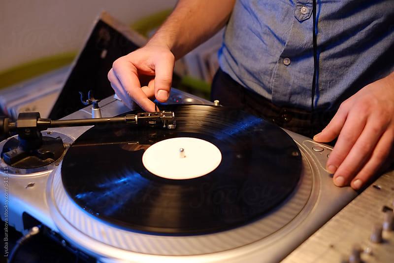 Dj put on a vinyl  by Lyuba Burakova for Stocksy United