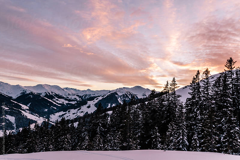 snowcovered mountain landscape in austrian alps at sunset by Leander Nardin for Stocksy United