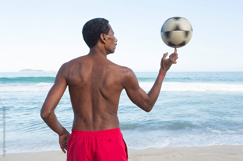 Brazilian with soccer ball. Ipanema Beach. Rio. by Hugh Sitton for Stocksy United