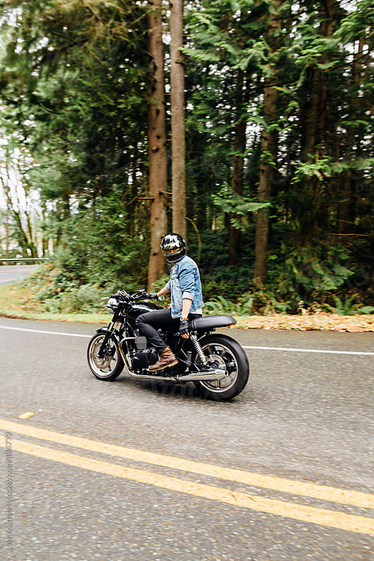Café Racer Motorcycle Rider Staring Back by Luke Mattson for Stocksy United