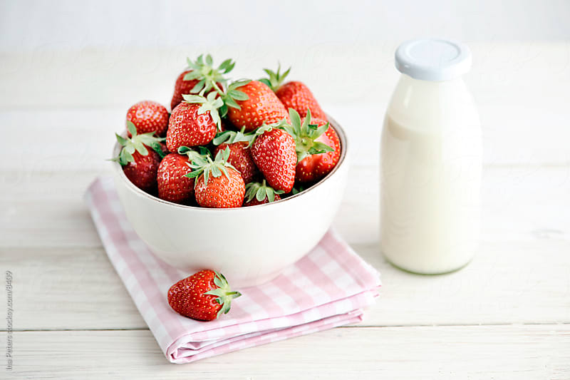 Strawberries in a bowl with Cream by Ina Peters for Stocksy United