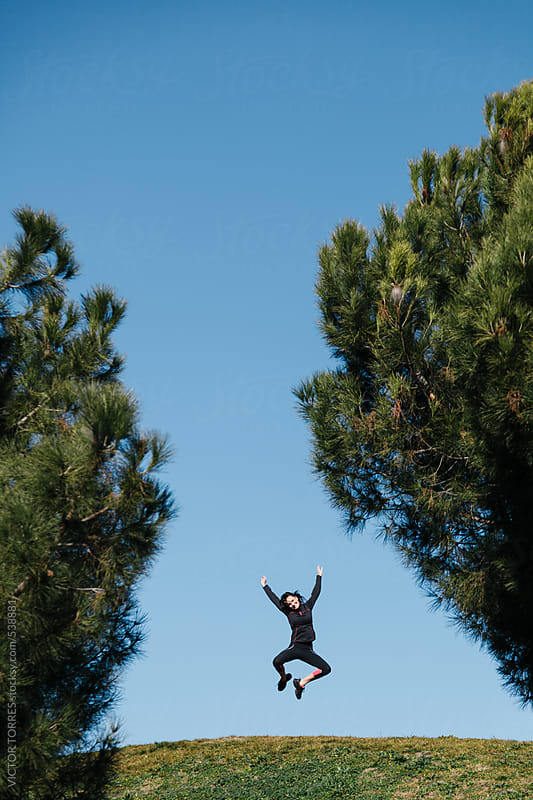 Woman Jumping While a Break at Workout by VICTOR TORRES for Stocksy United