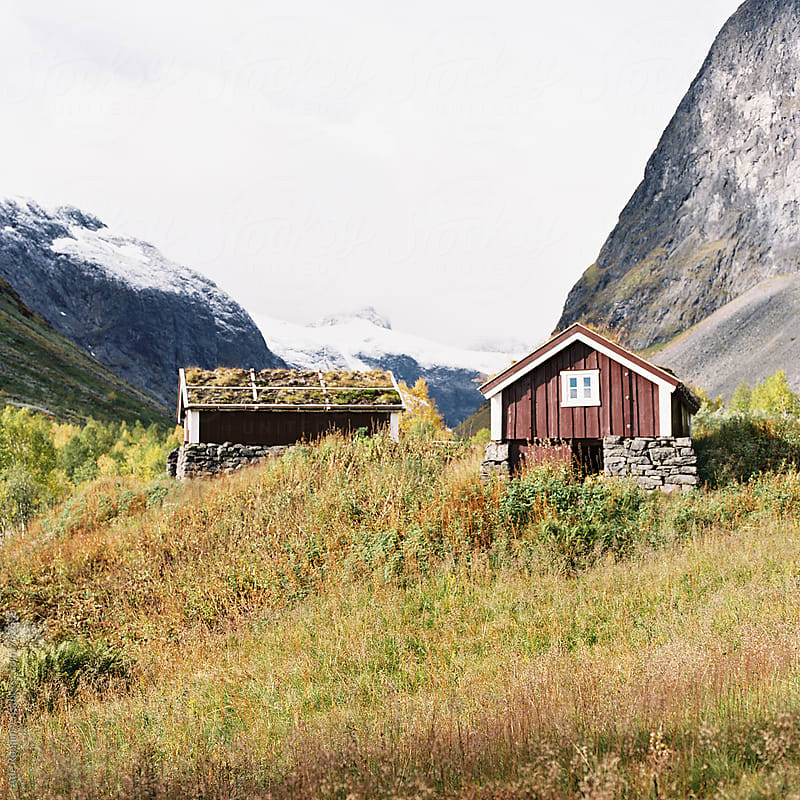Cabins in Størlsmaradalen in Norway surrounded by beautiful autumn colours by Atle Rønningen for Stocksy United