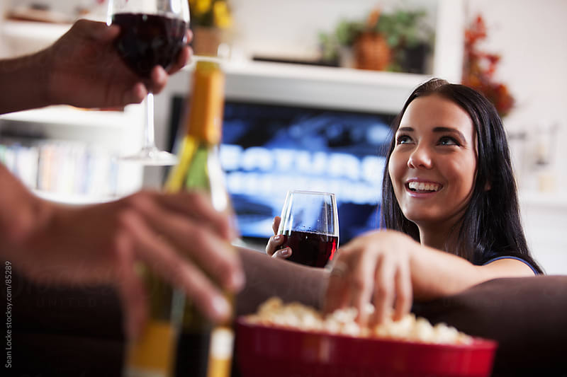 Television: Wine and Popcorn with Movie for Couple by Sean Locke for Stocksy United