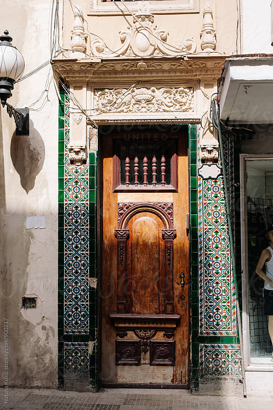 Streets of Havana,wooden door with colorful tiles around it by Natasa Kukic for Stocksy United