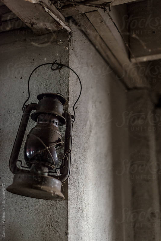 Busted Lantern  by Cameron Whitman for Stocksy United