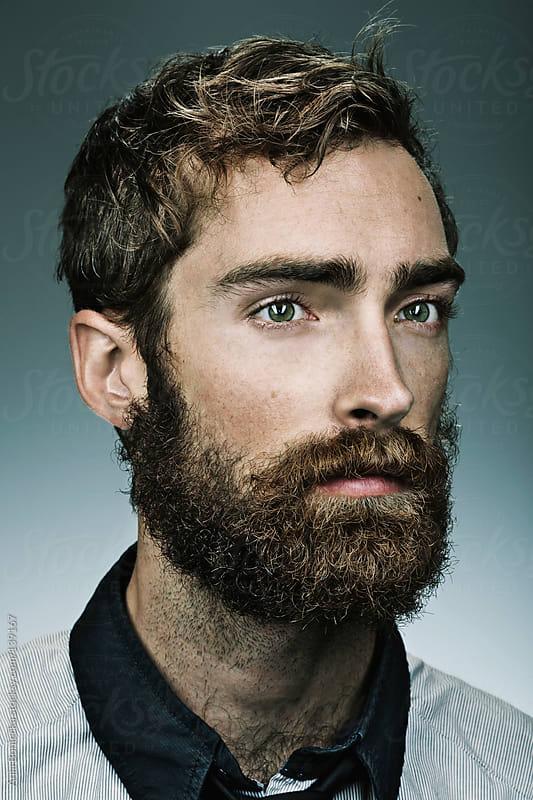 A portrait of a bearded man by Ania Boniecka for Stocksy United