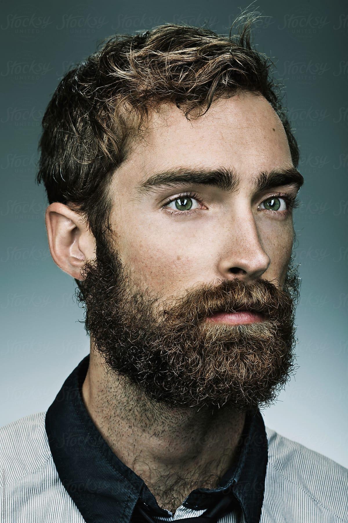 a portrait of a bearded man stocksy united
