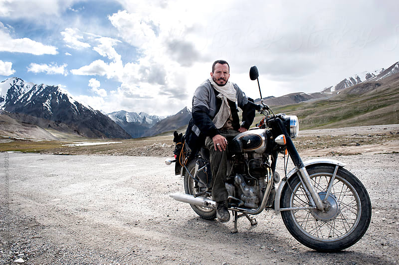 Biker at the end of the KKH, the Karakorum Highway the highest paved international road in the world by Jean-Claude Manfredi for Stocksy United