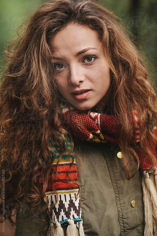 Sensual portrait of beautiful woman with scarf, outdoors by Aleksandar Novoselski for Stocksy United