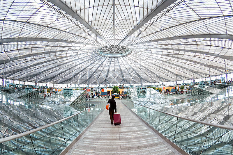 China, Shanghai, Interior of circular concourse and roof of the spectacular Shanghai South Railway Station  by Gavin Hellier for Stocksy United