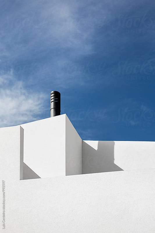 White wall and chimney by Luis Cerdeira for Stocksy United