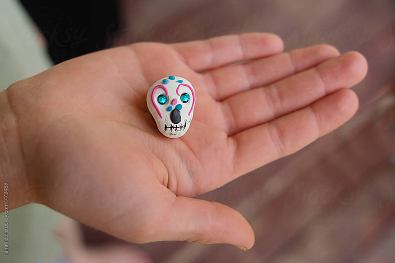Handmade Day of the Dead modeling clay skull by Tana Teel for Stocksy United