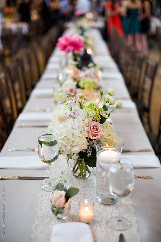 Family style dinner table by ZOA PHOTO for Stocksy United