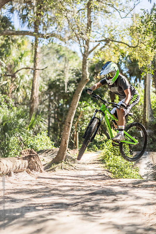 Woman Mountain Biker Catches Air on Jumps by suzanne clements for Stocksy United