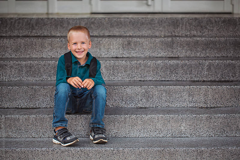 Schoolboy Sitting on the Stairs by Lumina for Stocksy United