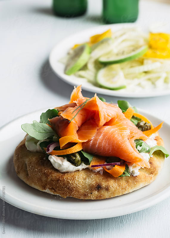 Toasted Bread with smoked salmon and vegetables by Davide Illini for Stocksy United