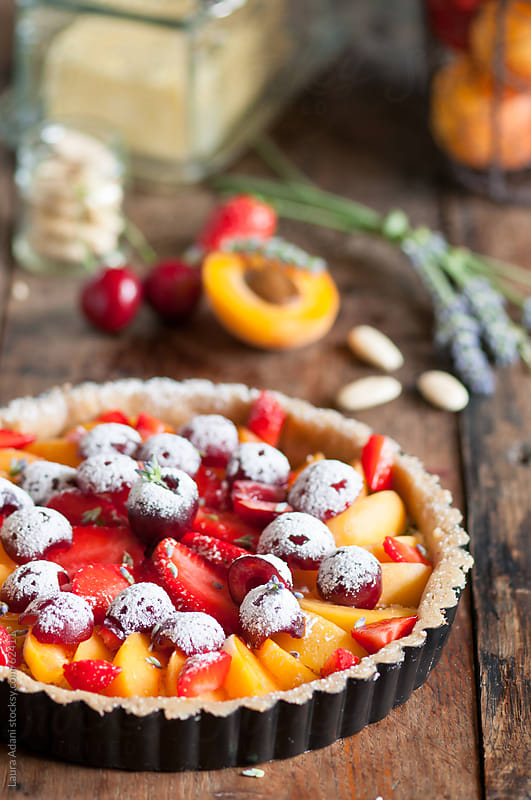 fruit tart in a mold by Laura Adani for Stocksy United