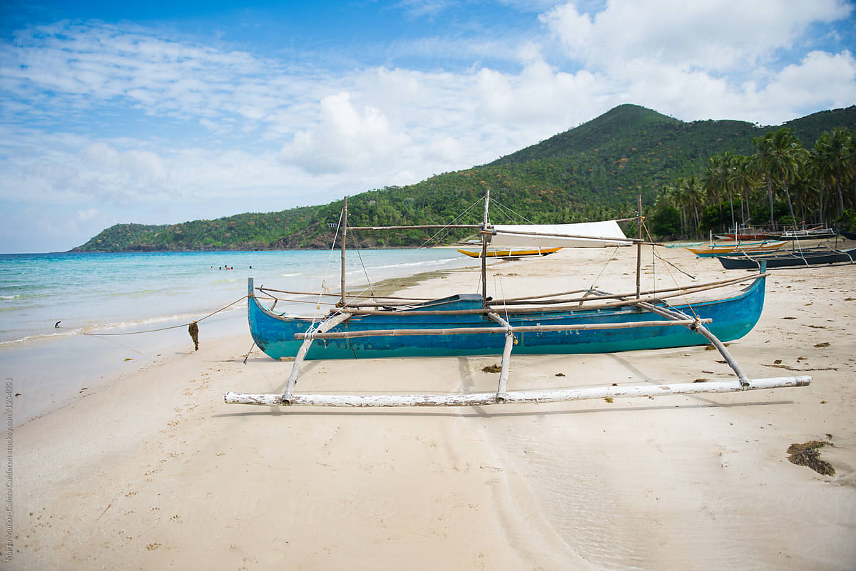 traditional philippines fishing boat with outriggers often known as
