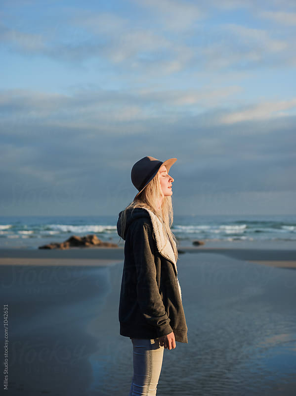 Woman at beach in morning by Milles Studio for Stocksy United