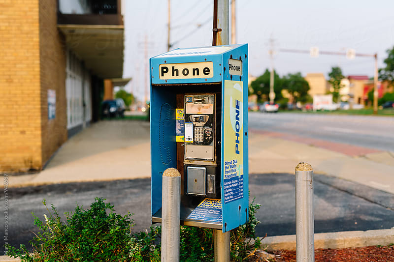 broken payphone by Maria Manco for Stocksy United